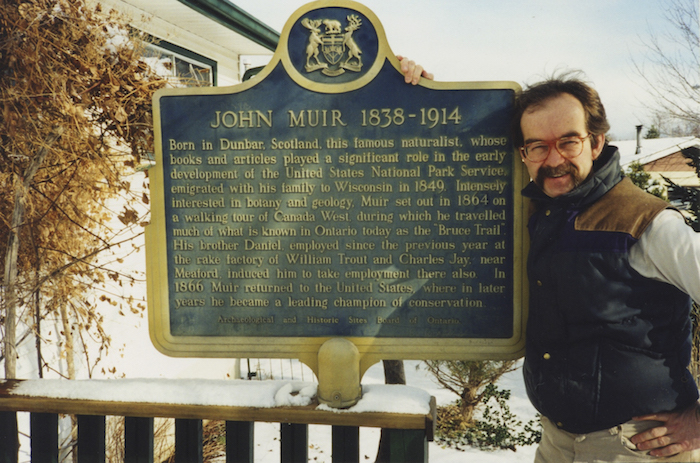 A photo of Robert Burcher and the Muir Plaque he restored